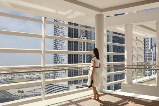 Oberoi - K1600_New-Balcony-Shot-with-model.jpg