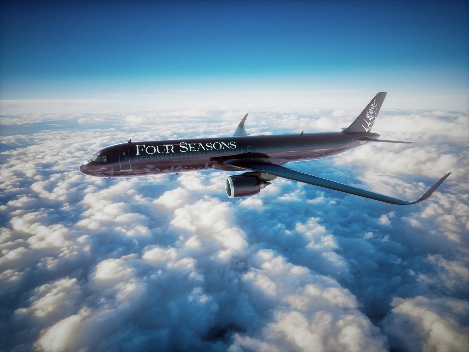Der Four Seasons Private Jet in der Luft über den Wolken vor blauem Himmel